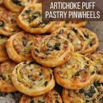 a side view of puff pastry pinwheels on a stone platter