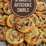 a stone platter topped with golden brown spinach and artichoke swirls