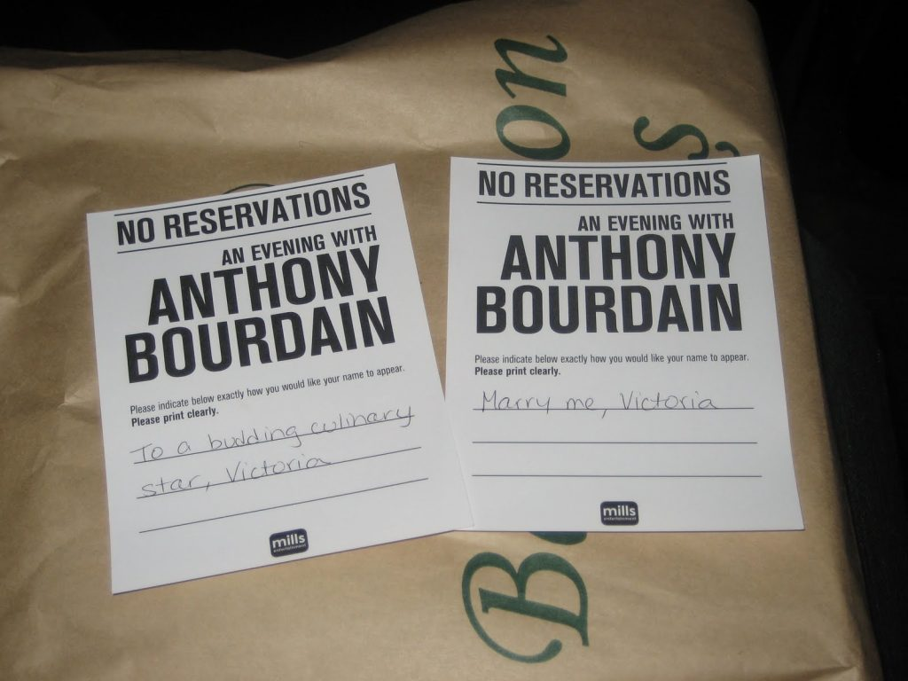 two pieces of paper that say No Reservations An Evening with Anthony Bourdain