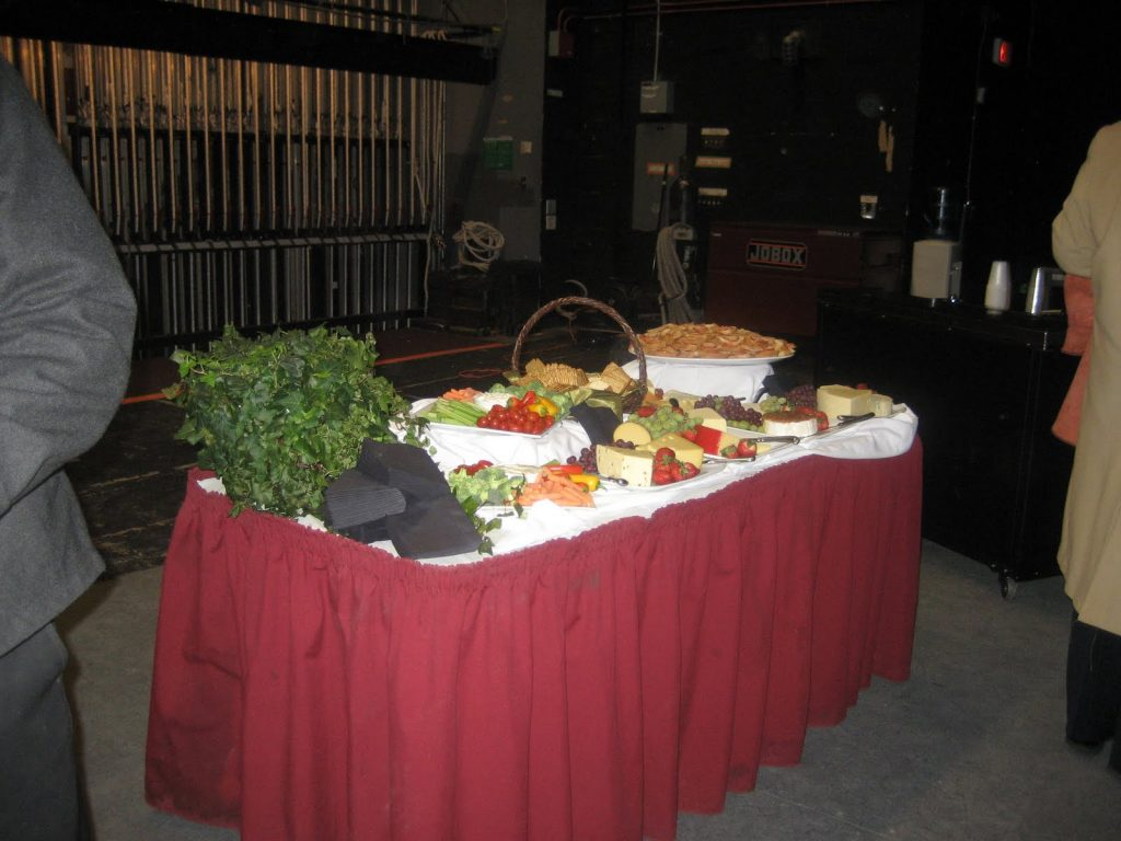 a buffet table set up with platters of food