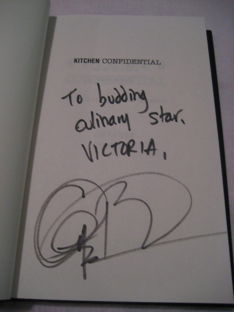 Anthony Bourdain\'s autograph inside a copy of Kitchen Confidential