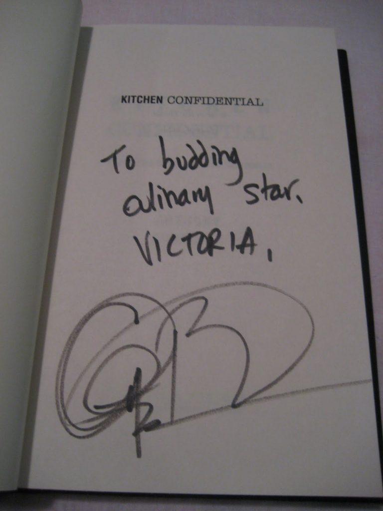 Anthony Bourdain\'s autograph inside a copy of Kitchen Confidential