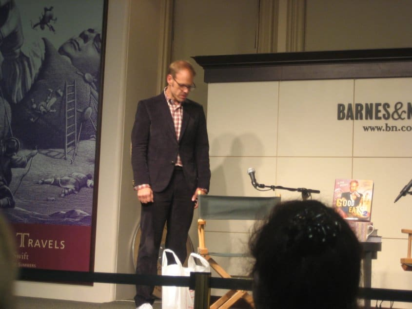 Alton Brown standing on a stage