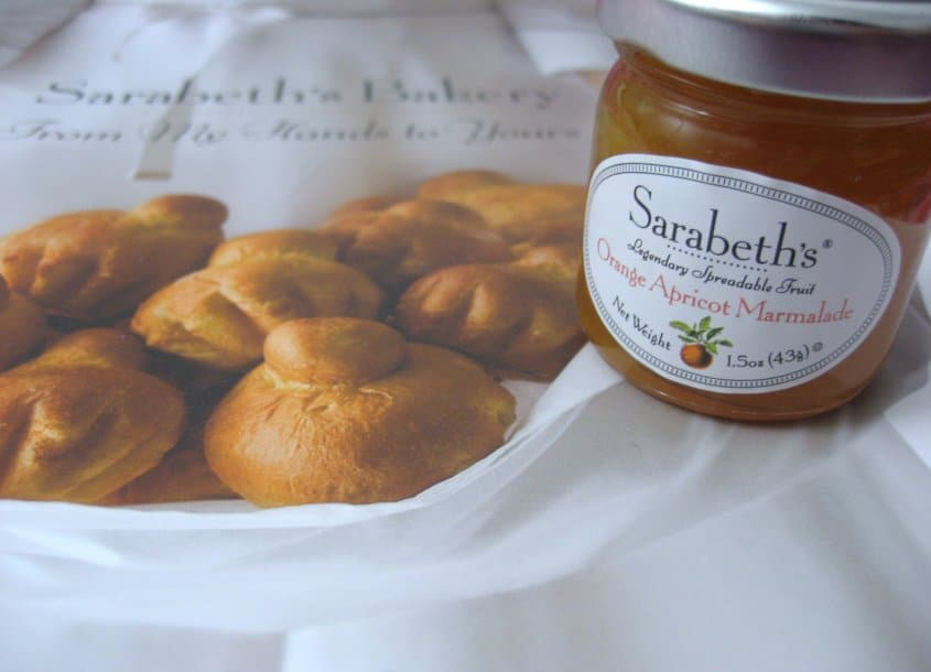the cover of a cookbook with brioche buns and a small jar of jam