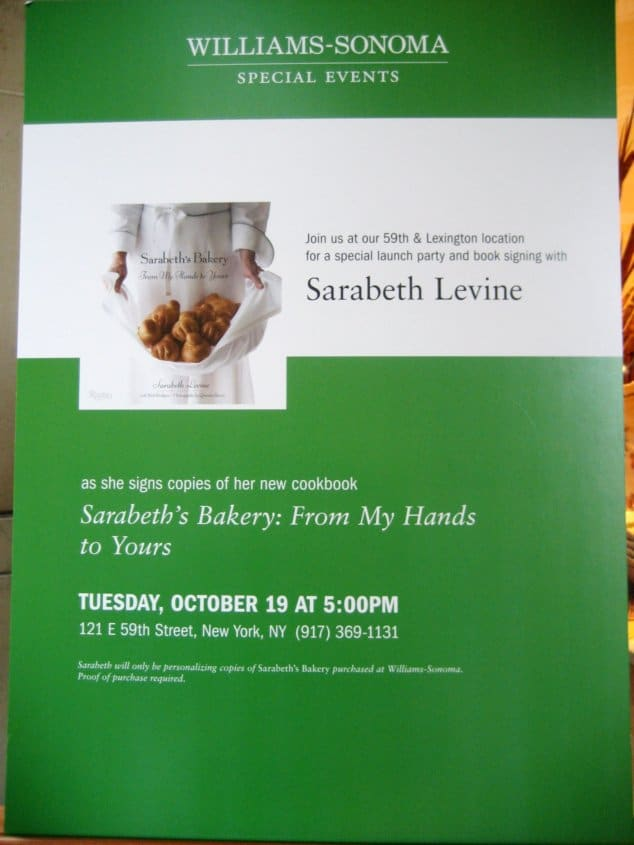 a white and green sign that says Sarabeth Levine with information about a book signing