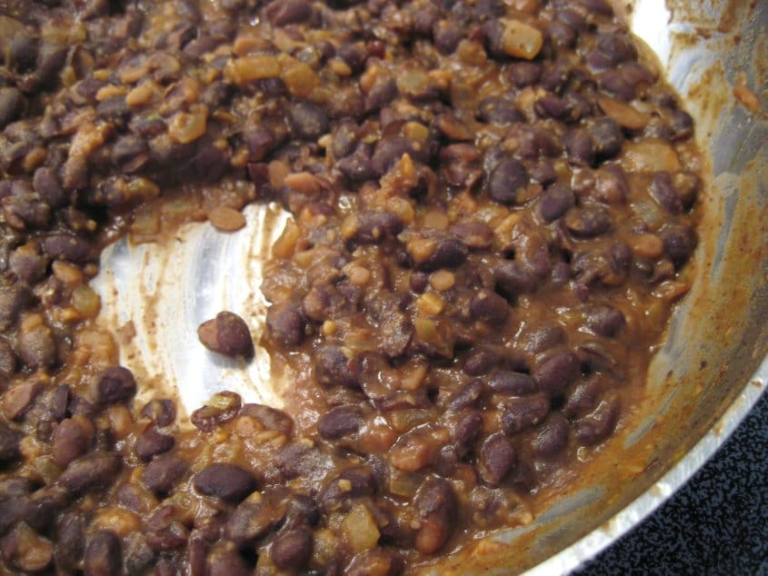 cooked black beans in a metal pan