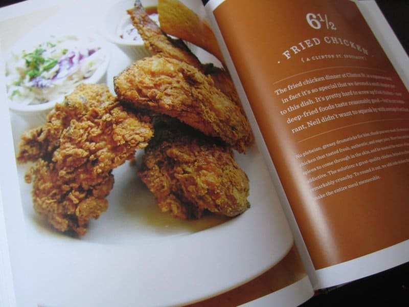snapshot of a photo in a cookbook of fried chicken on a white plate