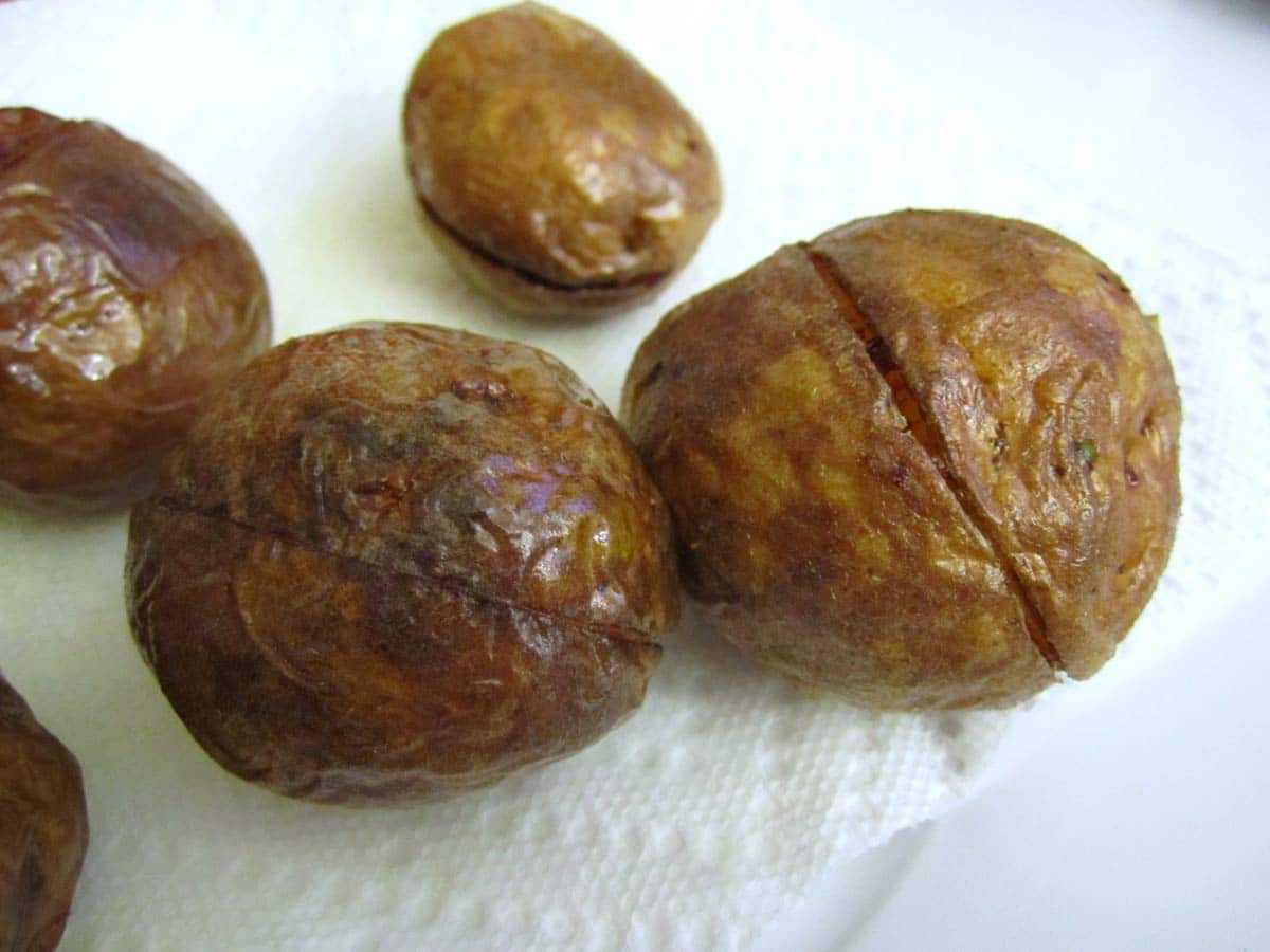 Small whole fried potatoes.