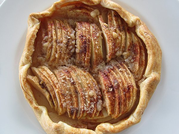 overhead view of a free-form apple tart with two rows of sliced apples
