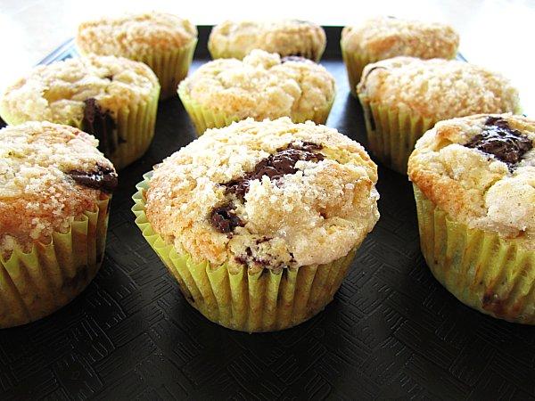 banana chocolate chunk muffins arranged on a black tray