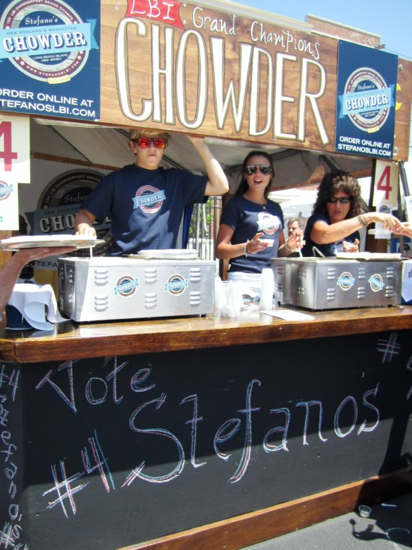 a booth of people giving out samples of chowder