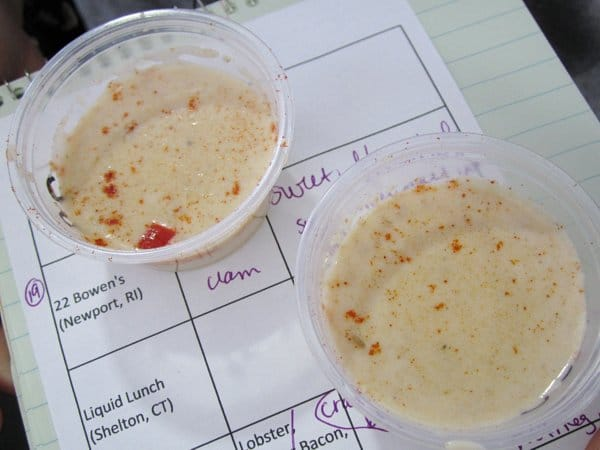 two small cups of white chowder on a notepad used as a tray
