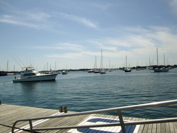 a view of boats in the water near a dock