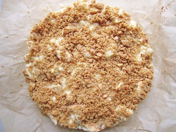 overhead view of a round cake topped with crumbs