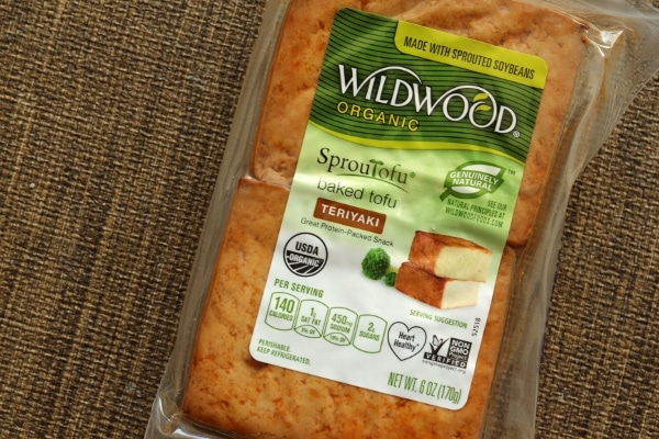 a package of Wildwood brand baked tofu in Teriyaki flavor with a green label
