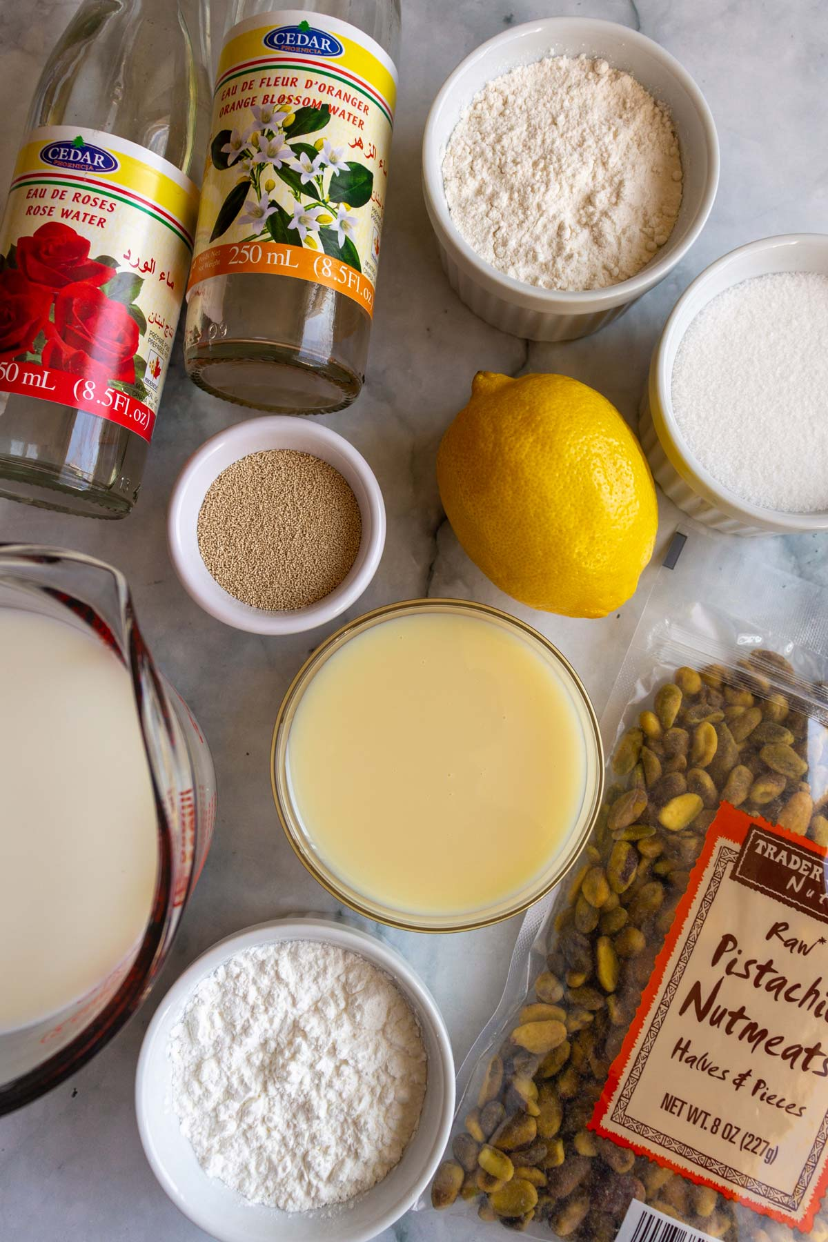 Rose and orange blossom water, flour, sugar, cornstarch, yeast, milk, condensed milk, a lemon and pistachios.