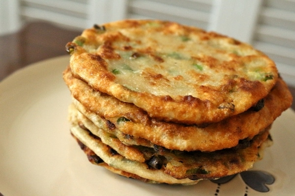 a stack of fried Chinese scallion pancakes on a plate