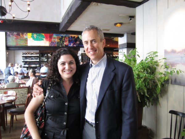 a woman posing with Danny Meyer in a restaurant