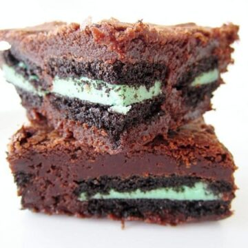 closeup of a stack of two brownies stuffed with mint oreos