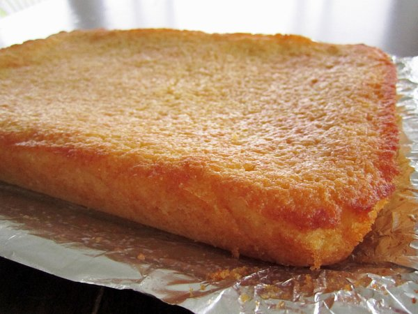 side view of a baked corn bread before being sliced into squares