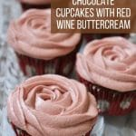 closeup of cupcakes with red wine buttercream frosting piped to look like a rose