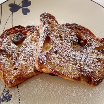 overhead view of two slices of French toast topped with powdered sugar