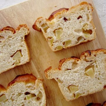 overhead view of slices of apple bread on a wooden board