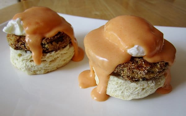 side view of Eggs Benedict on biscuits with fried green tomatoes and buffalo Hollandaise sauce