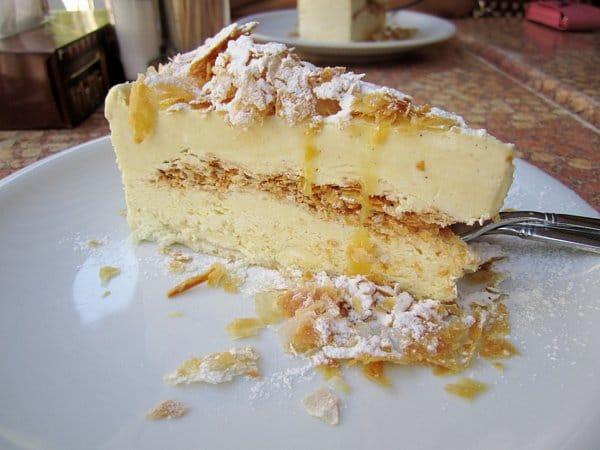 a slice of vanilla ice cream cake with crispy filo dough and powdered sugar