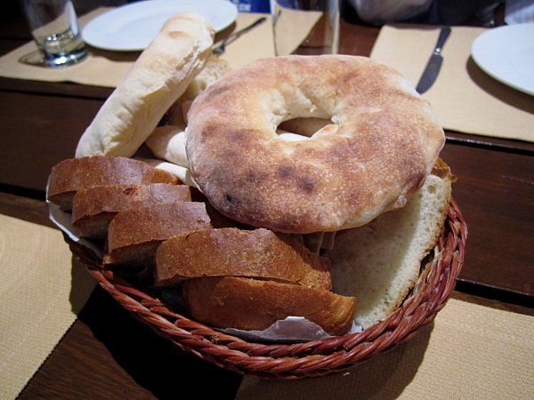a bread basket with a variety of breads in it