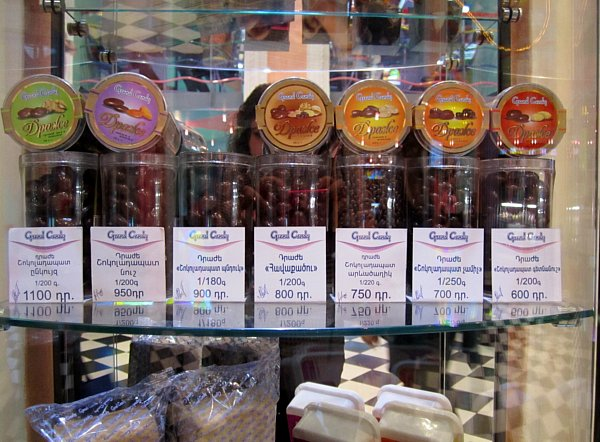 containers of chocolates on display in a store for sale