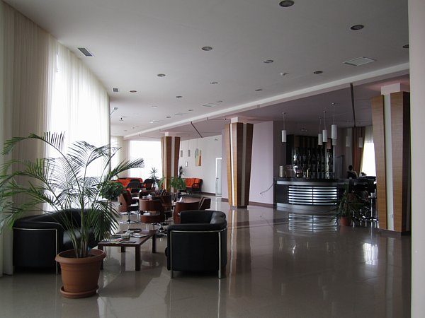 a hotel lobby with couches and coffee tables