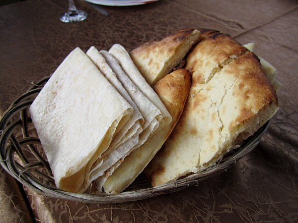 a bread basket with lavash and maknakash breads