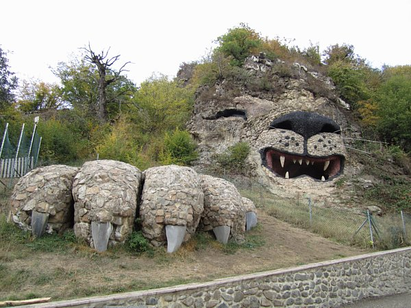 a large rock on a hillside made to look like a lion