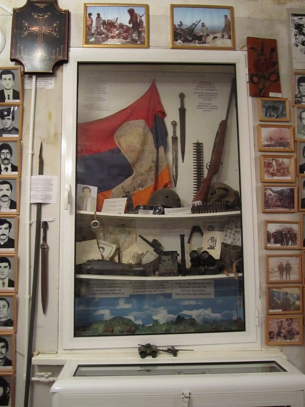 a museum exhibit with a flag and weapons