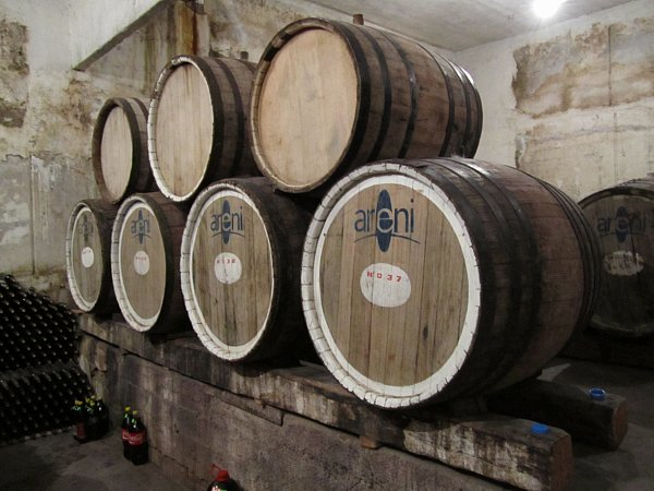 stacked wine barrels that say Areni on the side