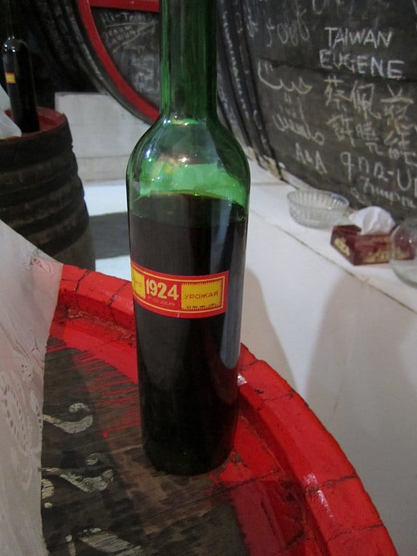 A bottle of alcohol with a red and yellow label