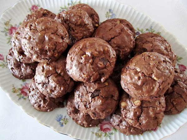 overhead view of chocolate cookies piled on an oval serving platter