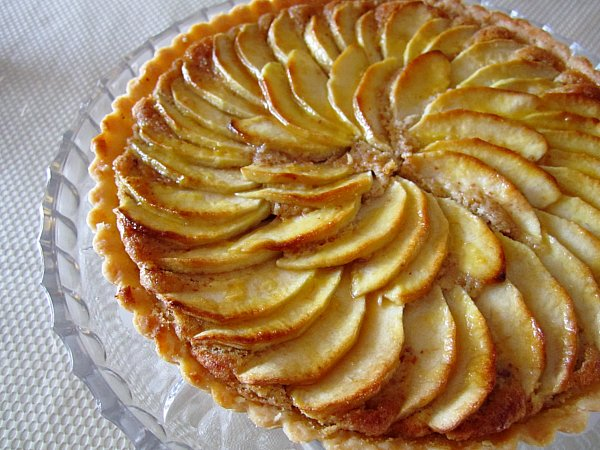 a French apple tart with apple slices arranged in a spiral on top