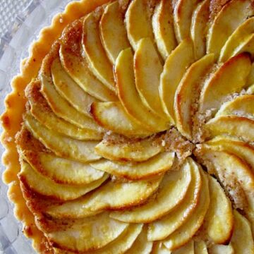overhead closeup of a French apple tart with beautifully arranged apple slices on top