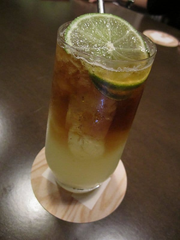 a closeup of a cocktail with slices of lime on top