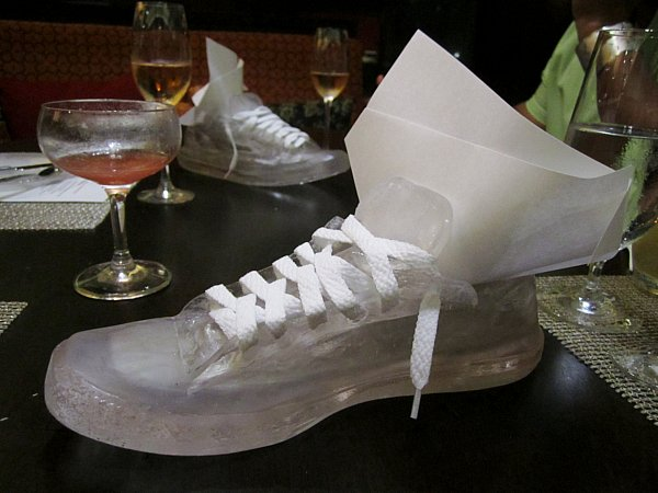 a sneaker shaped serving dish on a table
