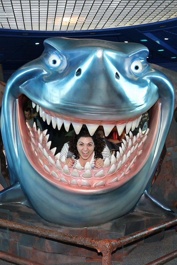 a woman posing inside a fake shark\'s mouth