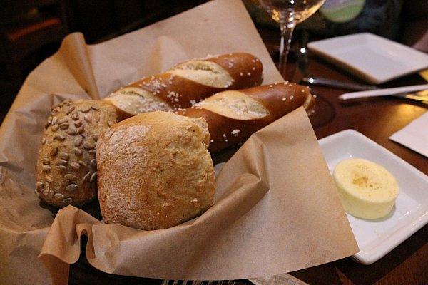 A basket of breads including pretzel sticks