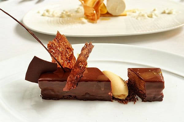 a closeup of a chocolate dessert on a white plate