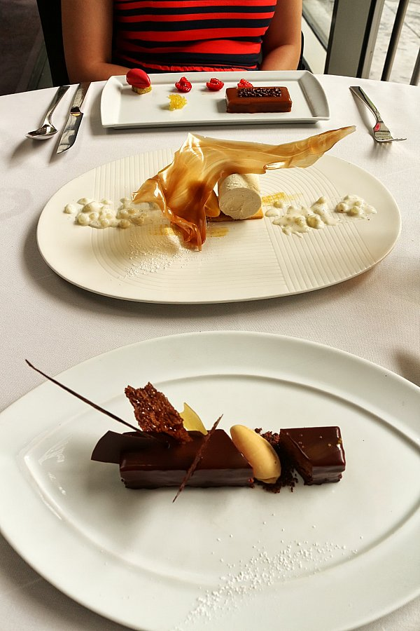 two artfully plated desserts on white plates