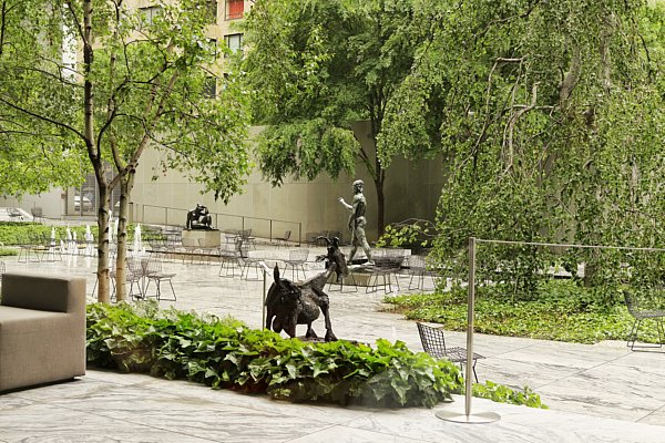 a sculpture garden with trees and statues