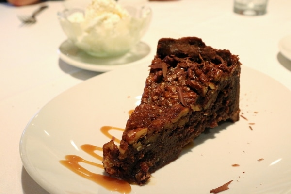 A slice of chocolate pie on a white plate