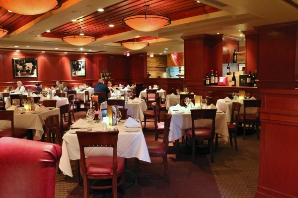 wide view of a restaurant interior with tables, chairs, and warm lighting