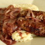 Homemade bangers and mash with red wine gravy